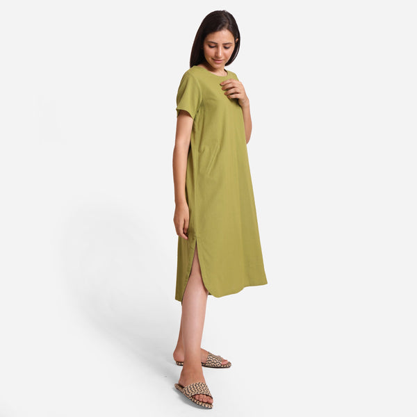 Right View of a Model wearing Khaki Green Cotton Welt Pocket Dress