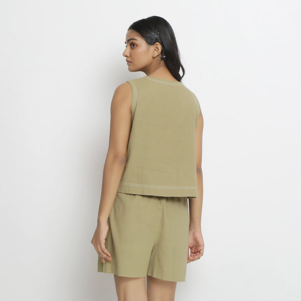 Back View of a Model wearing Khaki Handspun Vegetable Dyed Crop Top