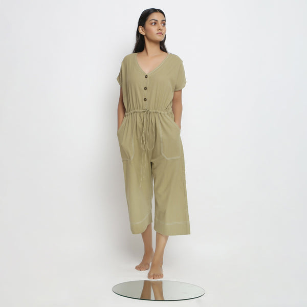 Front View of a Model wearing Khaki Green Vegetable Dyed Straight Jumpsuit