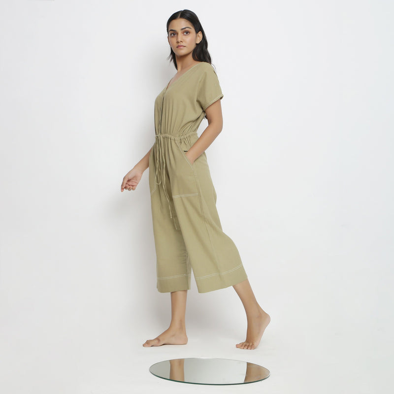 Left View of a Model wearing Khaki Green Vegetable Dyed Straight Jumpsuit