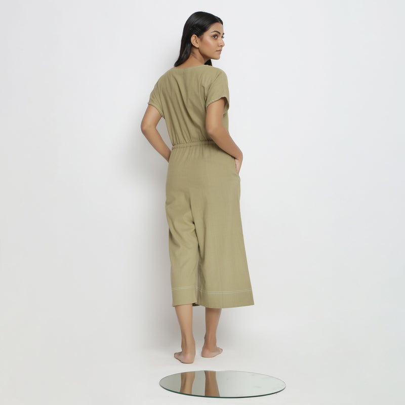 Back View of a Model wearing Khaki Green Vegetable Dyed Straight Jumpsuit