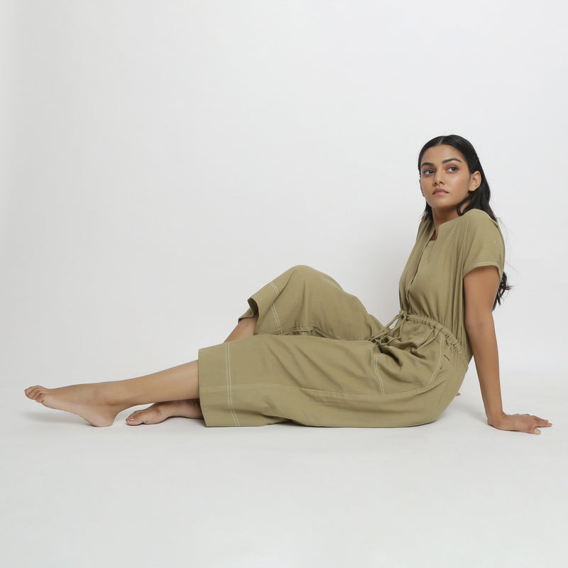 Left View of a Model wearing Vegetable Dyed Button-Down Jumpsuit