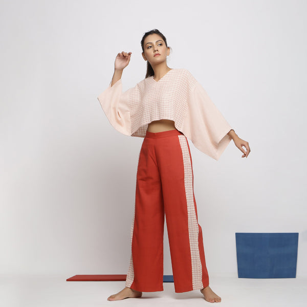 Front View of a Model wearing Kimono Sleeves Crop Top and Brick Red Pant Set