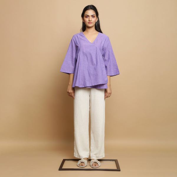 Front View of a Model wearing Lavender Asymmetrical Top and Undyed Pant Set