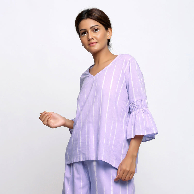 Left View of a Model wearing Lavender Hand Tie Dyed A-Line Top