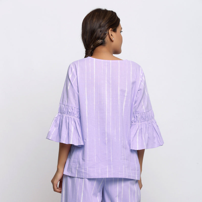 Back View of a Model wearing Lavender Hand Tie Dyed A-Line Top