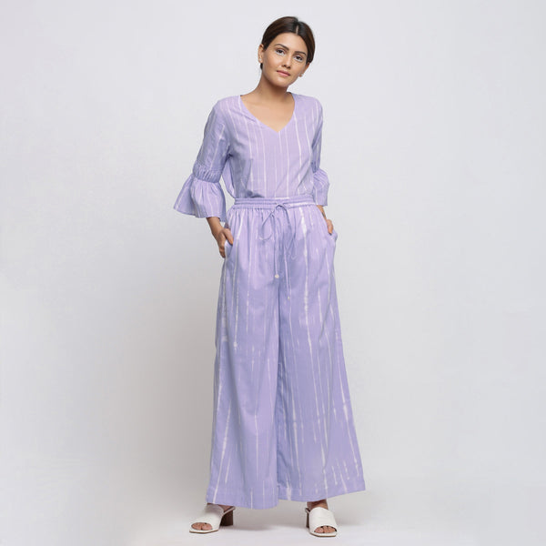 Front View of a Model wearing Lavender Tie Dye Wide Legged Palazzo Pant