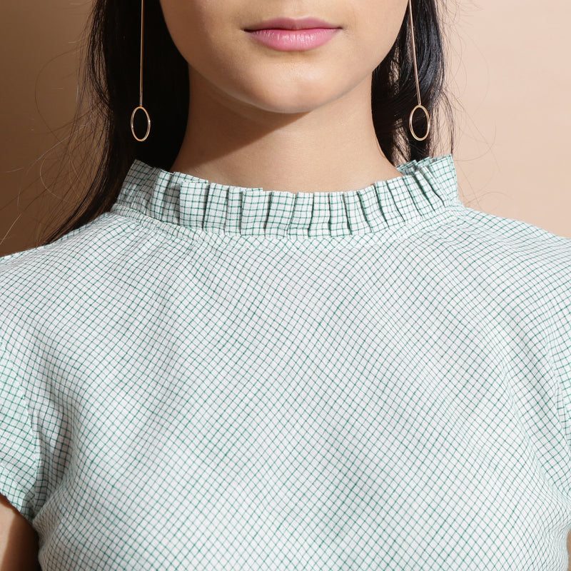 Front Detail of a Model wearing Light Green Cotton Muslin Flared Top