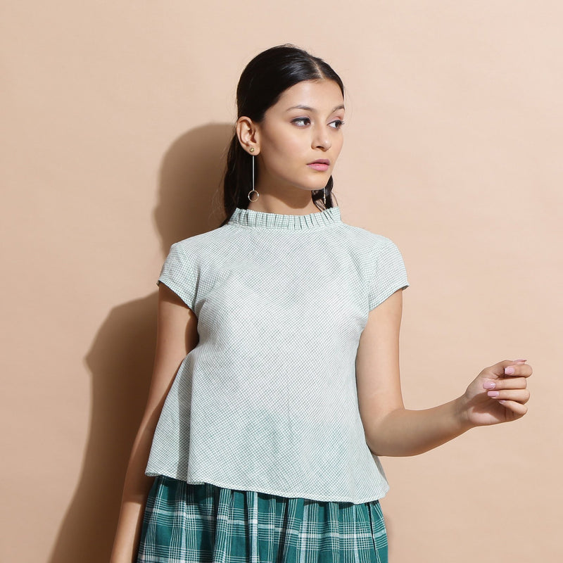 Front View of a Model wearing Light Green Cotton Muslin Flared Top