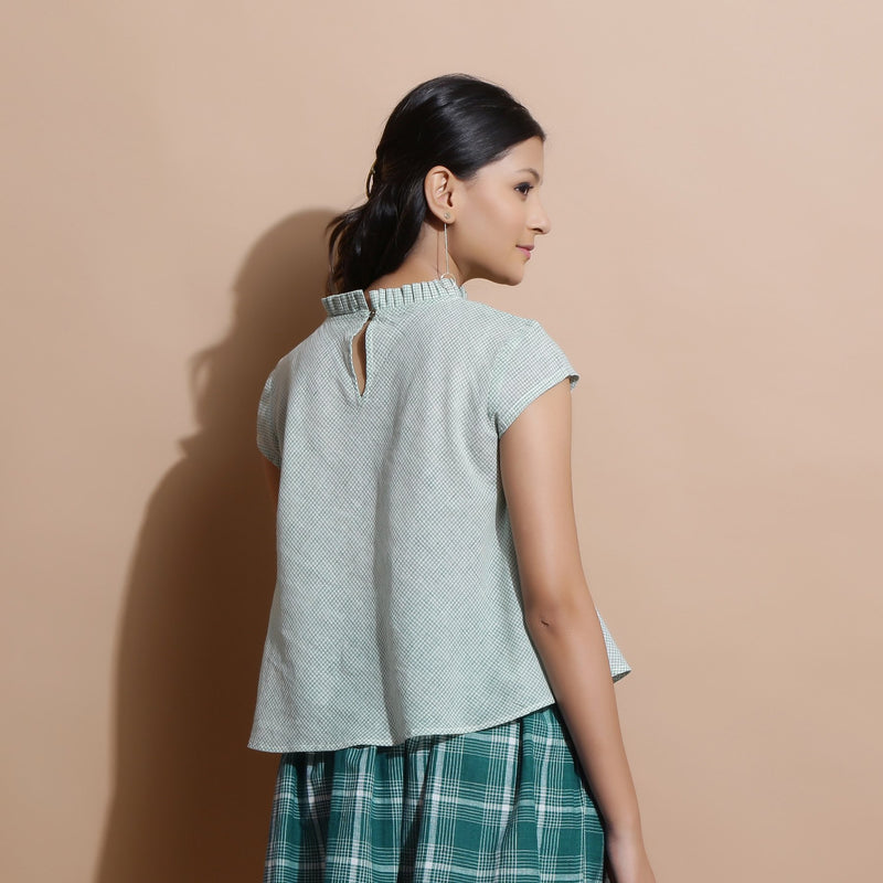 Back View of a Model wearing Light Green Cotton Muslin Flared Top