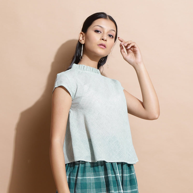 Right View of a Model wearing Light Green Cotton Muslin Flared Top