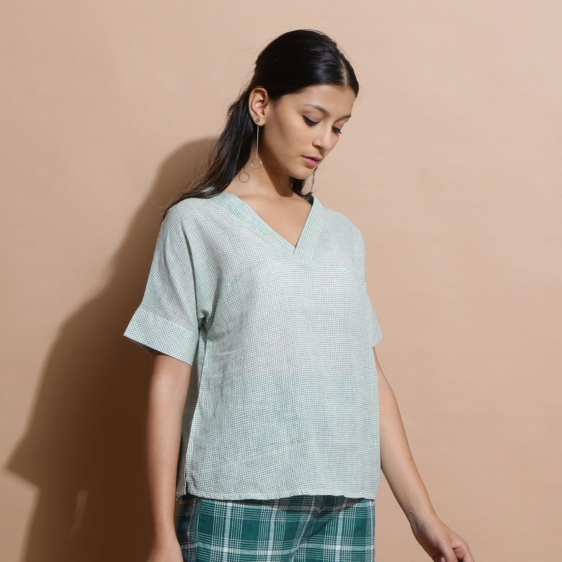 Right View of a Model wearing Light Green Cotton Straight Fit Top