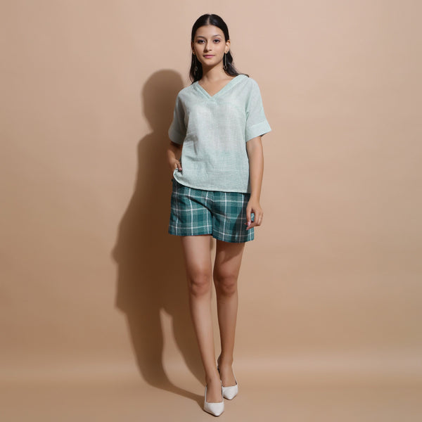 Front View of a Model wearing Light Green Handwoven Cotton Straight Top