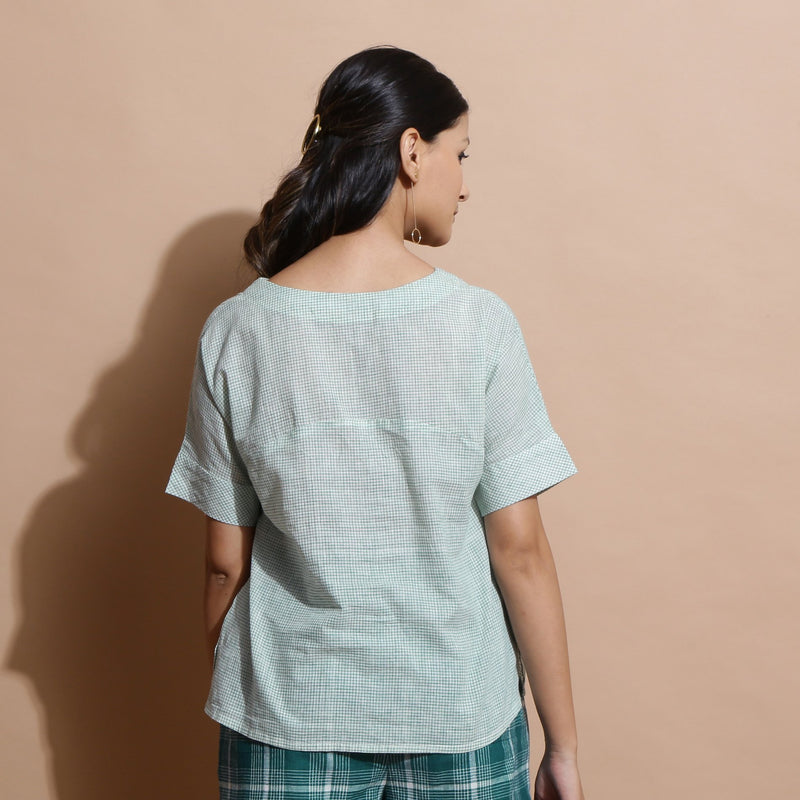 Back View of a Model wearing Light Green Cotton Straight Fit Top