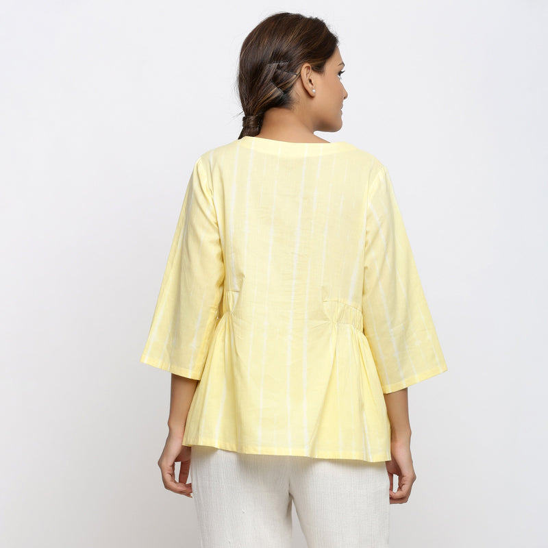 Back View of a Model wearing Light Yellow Cotton Button-Down Top