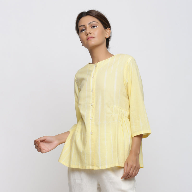 Front View of a Model wearing Light Yellow Cotton Button-Down Top