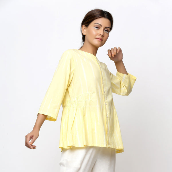 Right View of a Model wearing Light Yellow Cotton Button-Down Top