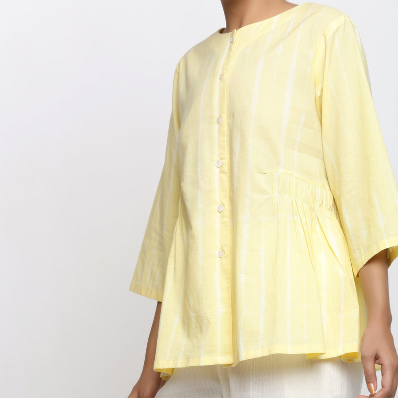 Front Detail of a Model wearing Light Yellow Cotton Button-Down Top