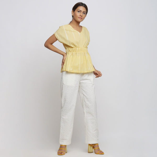 Front View of a Model wearing Light Yellow Hand Tie-Dyed Blouson Top
