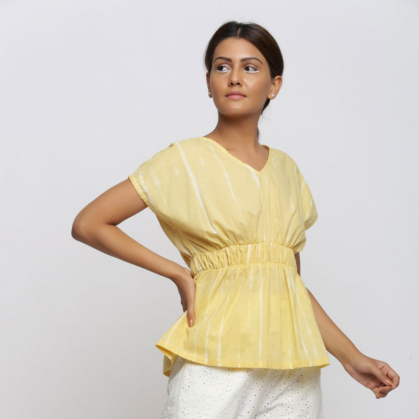Right View of a Model wearing Light Yellow Hand Tie-Dyed Blouson Top