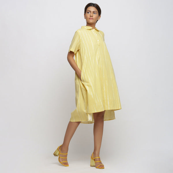 Right View of a Model wearing Light Yellow Tie And Dye High Low Dress