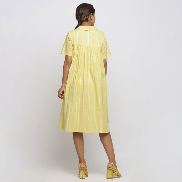 Back View of a Model wearing Light Yellow Tie And Dye High Low Dress