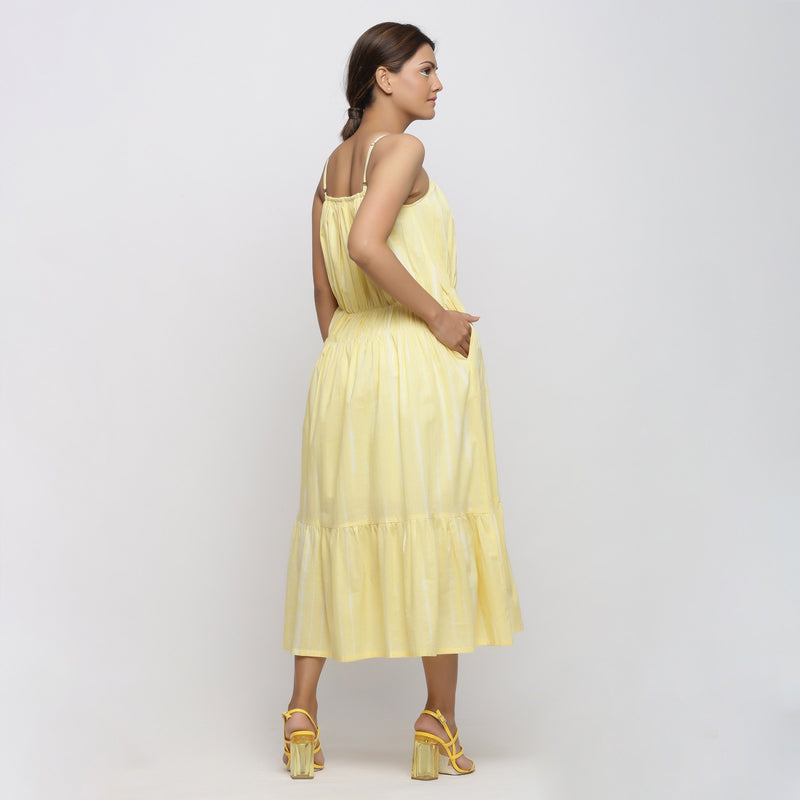 Back View of a Model wearing Yellow Tie and Dye Strap Tiered Dress