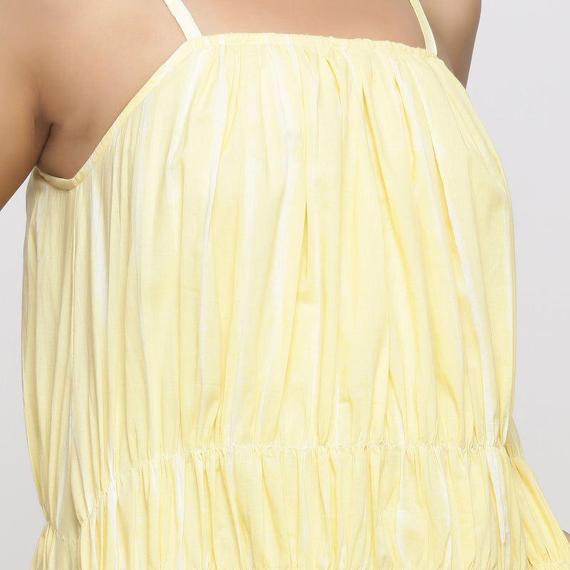 Front Detail of a Model wearing Yellow Tie and Dye Strap Tiered Dress