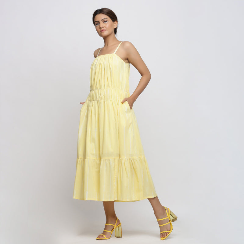 Left View of a Model wearing Yellow Tie and Dye Strap Tiered Dress