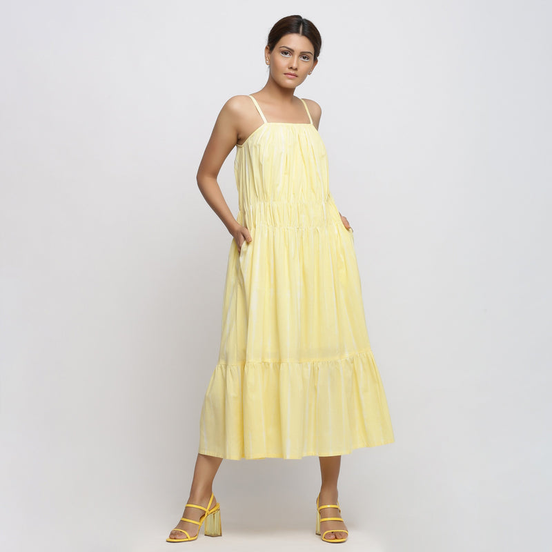 Front View of a Model wearing Yellow Tie and Dye Strap Tiered Dress