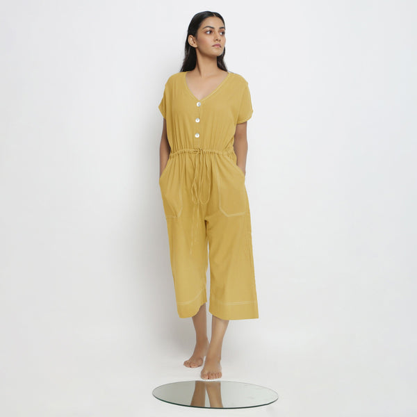 Front View of a Model wearing Light Yellow Vegetable Dyed Button-Down Jumpsuit