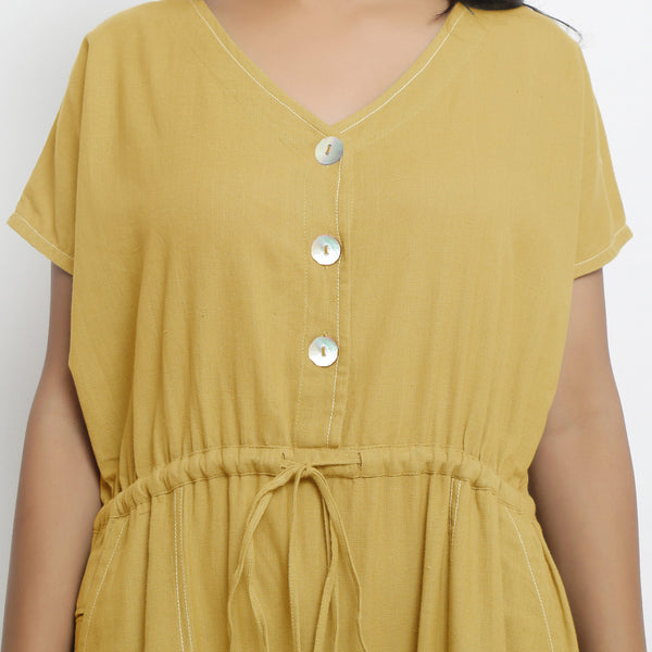 Front Detail of a Model wearing Light Yellow Vegetable Dyed Button-Down Jumpsuit