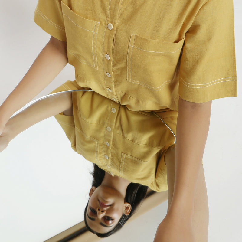 Front Detail of a Model wearing Light Yellow Vegetable Dyed Romper