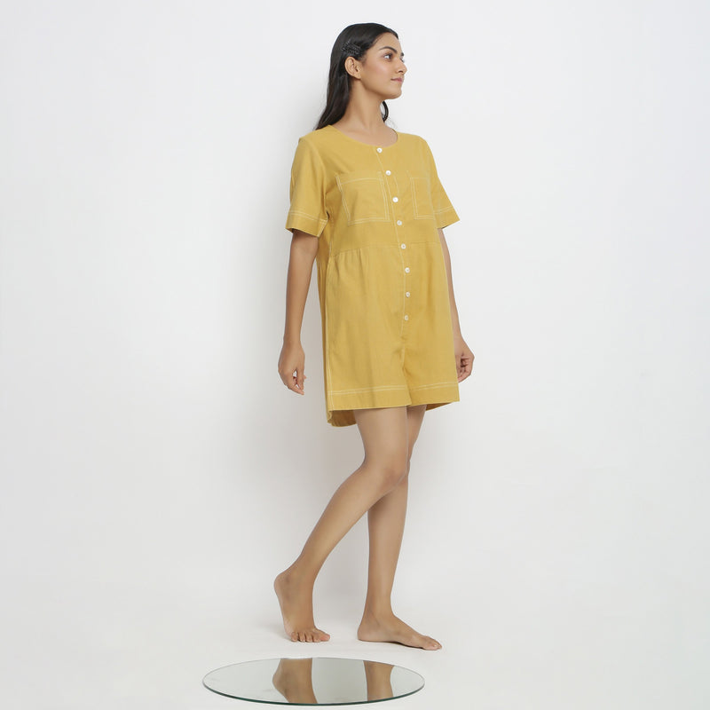 Right View of a Model wearing Light Yellow Vegetable Dyed Romper