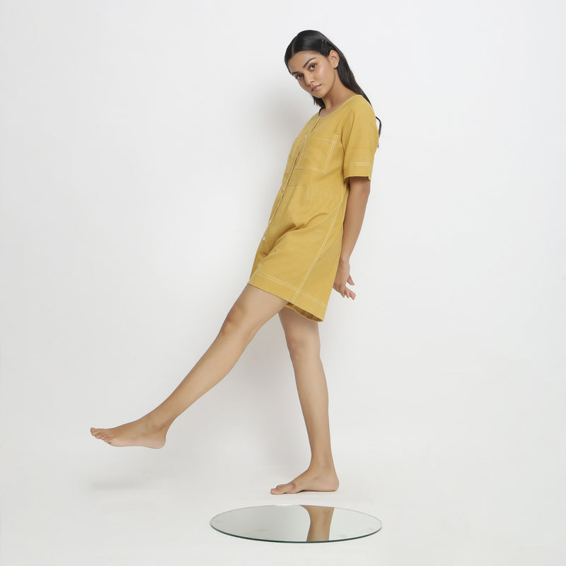 Left View of a Model wearing Light Yellow Vegetable Dyed Romper