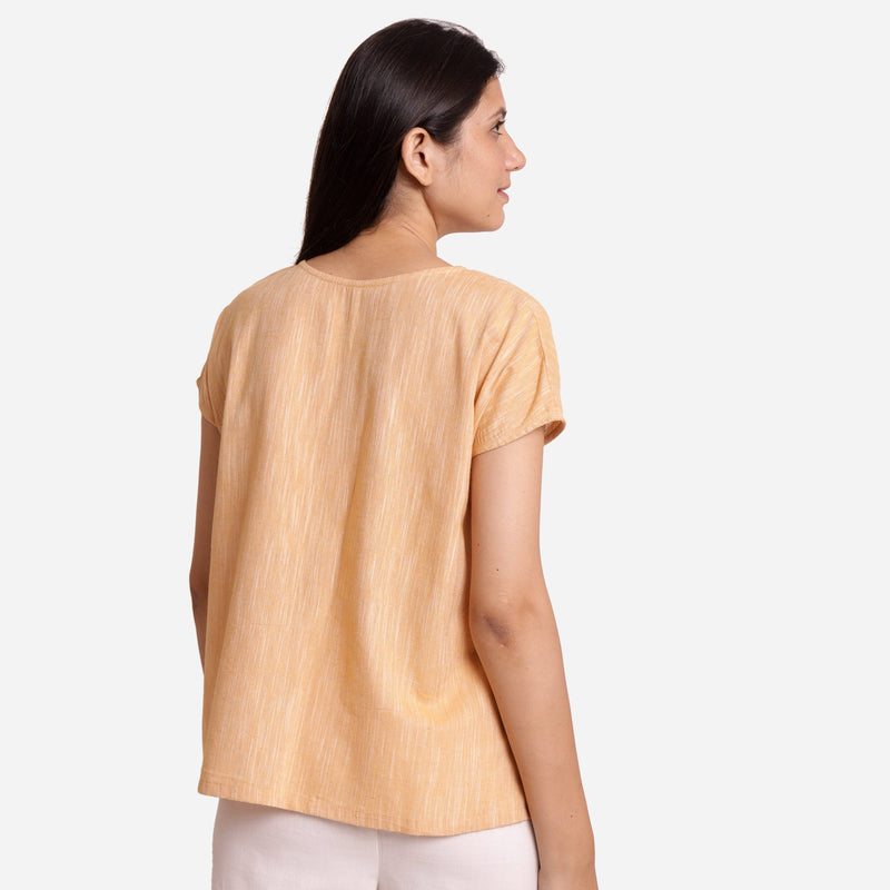 Back View of a Model wearing Light Yellow Boat-Neck Anti-Cling Top