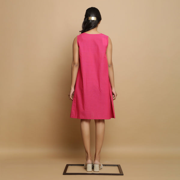 Back View of a Model wearing Magenta Hand-Embroidered Godet Dress