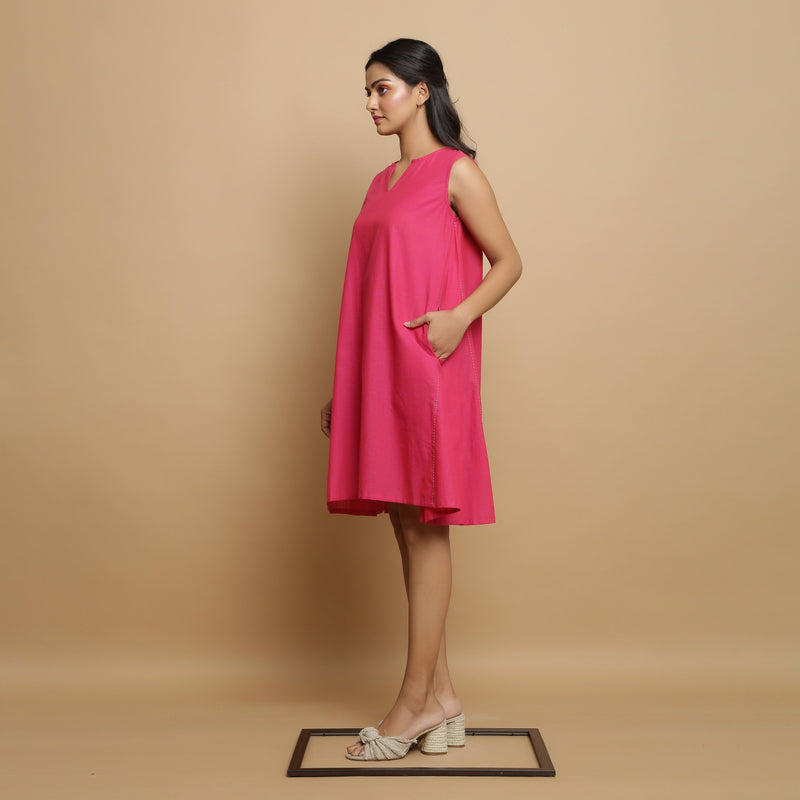 Left View of a Model wearing Magenta Hand-Embroidered Godet Dress
