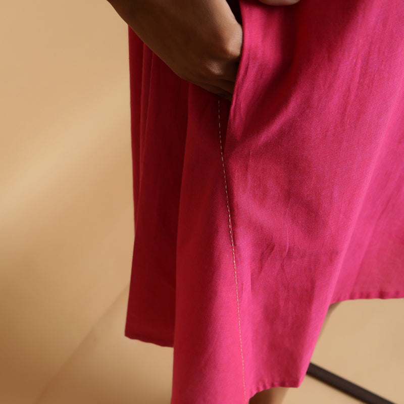 Right Detail of a Model wearing Magenta Hand-Embroidered Godet Dress