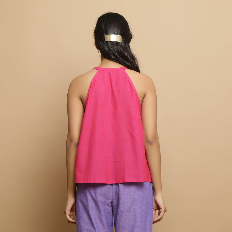 Back View of a Model wearing Magenta Mangalgiri Cotton Hand-Embroidered Flared Top