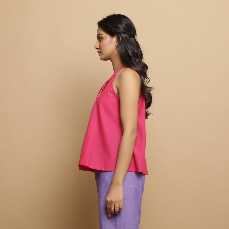 Left View of a Model wearing Magenta Mangalgiri Cotton Hand-Embroidered Flared Top