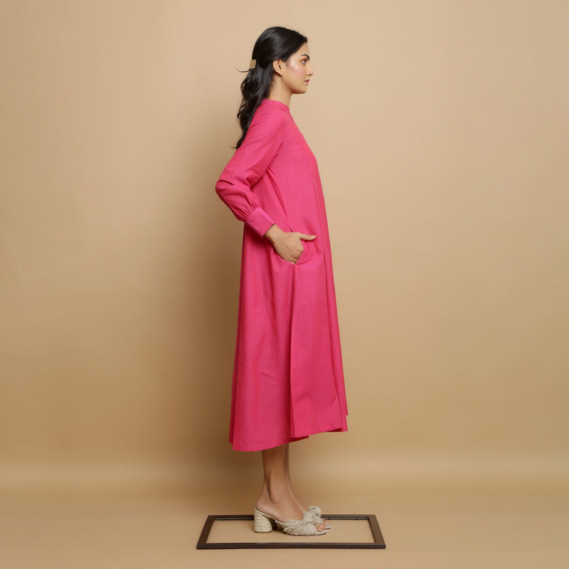 Right View of a Model wearing Magenta Mangalgiri Cotton Hand-Embroidered Godet Dress