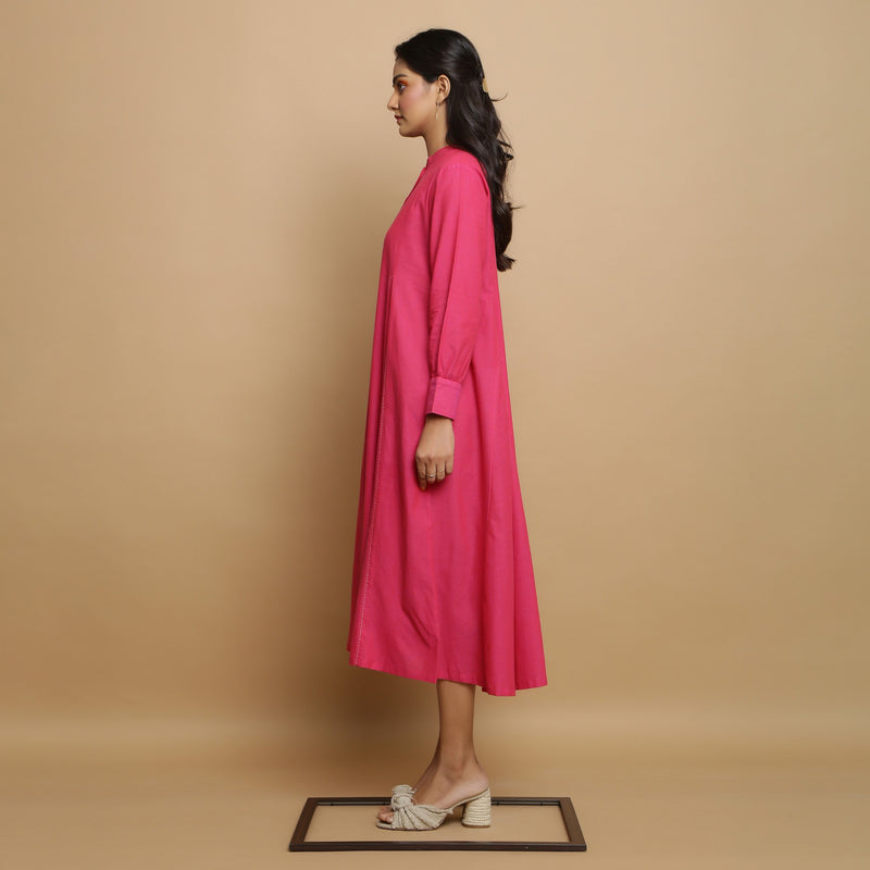 Left View of a Model wearing Magenta Mangalgiri Cotton Hand-Embroidered Godet Dress