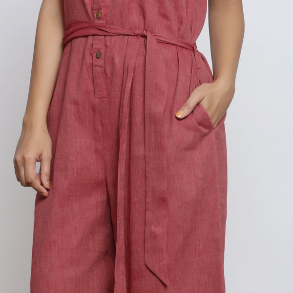 Front Detail of a Model wearing Button-Down Maroon Yoked Jumpsuit
