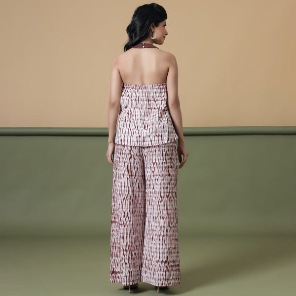 Back View of a Model wearing Maroon Shibori Flared Top and Pant Set