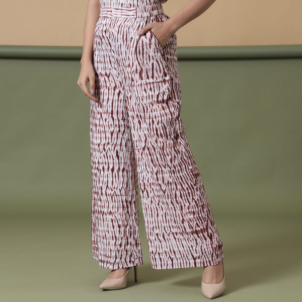 Front View of a Model wearing Maroon Shibori Wide Legged Pant