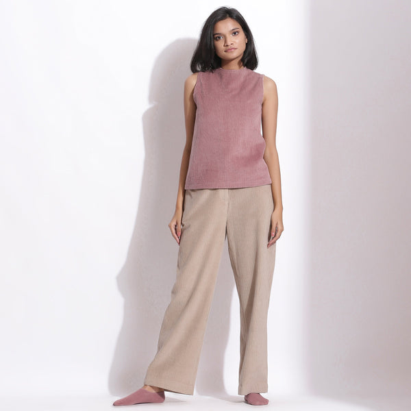 Front View of a Model wearing Mauve Cotton Corduroy Funnel Neck Top