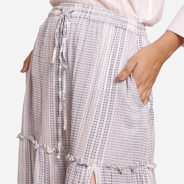 Front Detail of a Model wearing White Crinkled Cotton Tier Maxi Skirt