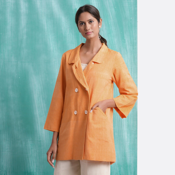 Front View of a Model wearing Melon Orange Welt Pocket Handwoven Coat