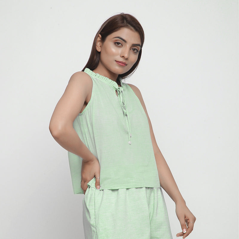 Right View of a Model wearing Mint Green Cotton Ruffled A-Line Top